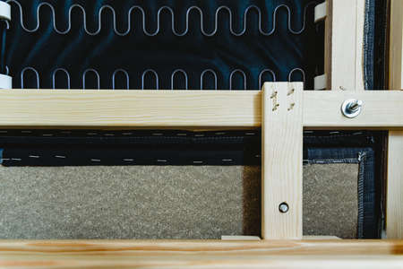 Wooden frame and metal tensioners inside the structure of a new sofa.