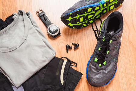 Accessories for running with wireless earbuds with an ultra trail gps watch.