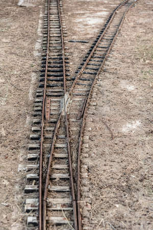 Small abandoned train tracks are a game for children.