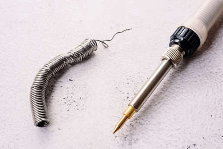 Tin soldering iron isolating in background with copy space. 免版税图像