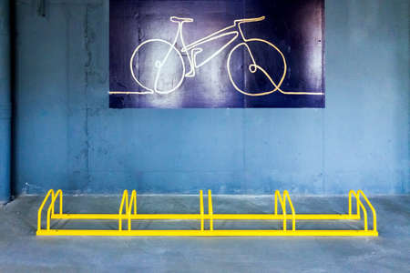 An original bicycle parking in an industrial urban area in an effort for sustainable mobility. 免版税图像