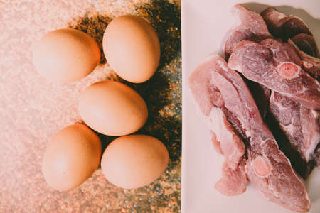 Raw meat and eggs for cooking