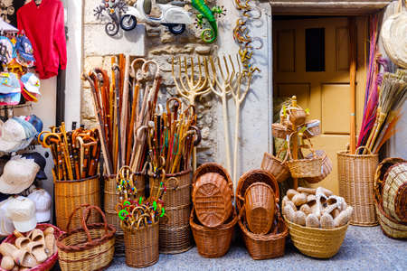 Morella, Spain - July 9, 2021: Baskets and other tourist souvenirs on a tourist street.
