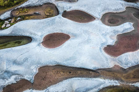 Aerial view of the meanders of a bedrock river during the summer drought.