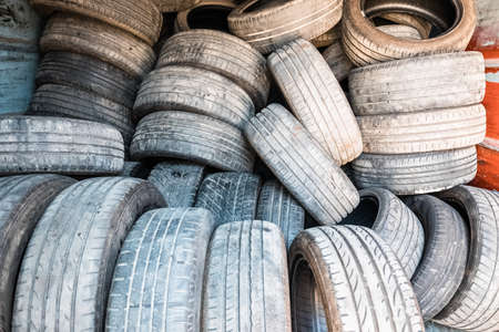 Detail of old used and retired tires, piled up in a treatment plant.