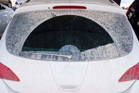 After a rain of mud, cars appear dirty with a layer of dirt.