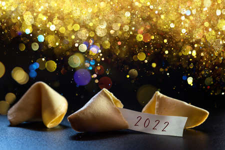 Label congratulating the new year 2022 on a lucky cookie, ideal for greeting cards.