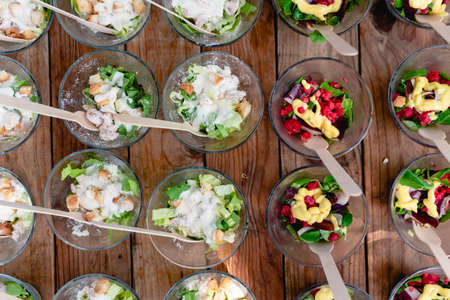 Many healthy snack bowls arranged for guests at a gastronomic celebration.