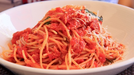 Full plate of spaghetti with tomato sauce. Stock Photo