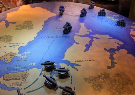 Detailed tactical map with ships and cannons in an attack stage.