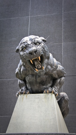 Bronze monument of black and dangerous panther.