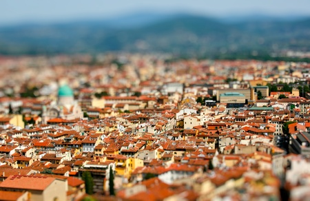 View on toy city with houses of orange roofs. Stock Photo