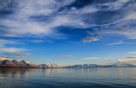 Magnificent view on a lake; mountains with snow tops on background add great composition
