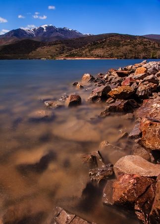 Beautiful shot from a coastline of Deer Creek Reservoir  Mountains on background add interesting view