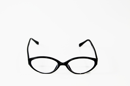 shortsightedness: black frame oval glasses over white background Stock Photo