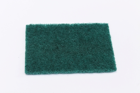 scour: a dark green rectangle kitchen dish scouring scrub pad on white background