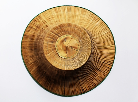 interweave: a hat made of bamboo and palm leaves shaped like an inverted basin