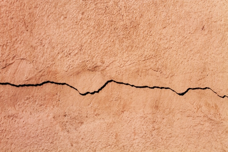 cleave: crack up of cement wall
