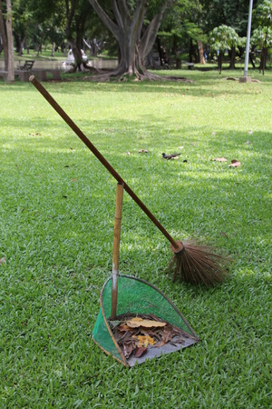 besom: a broomstick with a dustpan on ground Stock Photo