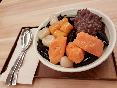 Close-up Bowl of Grass Jelly with Potatoes, Mochi, and Red Beans