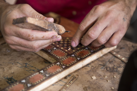 Wood craftsman making detailed wooden inlay work Stock Photo