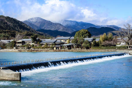 ogimachi: River with Mountain Background Stock Photo