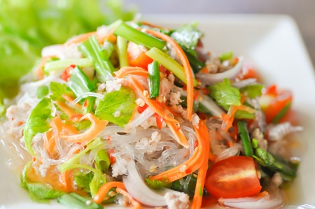 Thai salad with carrot, tomato, glass noodle, celery  and pork