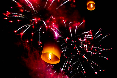 Sky lantern and fireworks in the night sky
