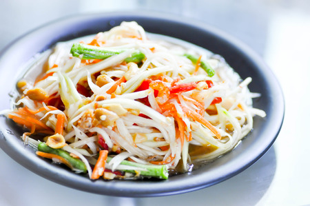 papaya salad or papaya,carrot,cow-pea ,pea and dried shrimp salad photo