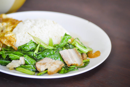 stir fried: Stir Fried Kale with crispy pork dish Stock Photo