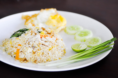 fried egg: fried rice with fried egg and vegetable