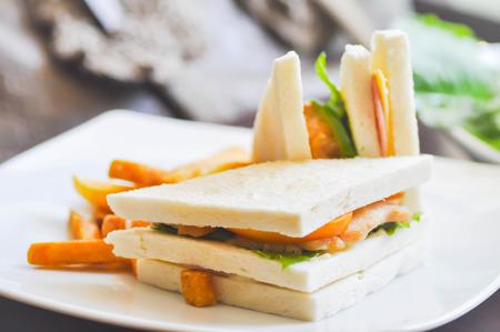 chicken sandwich: chicken sandwich with French fries dish Stock Photo
