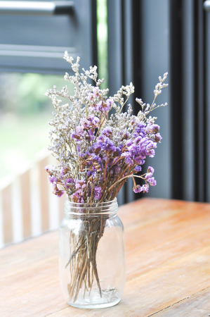 dried flower arrangement: statice flowers in a vase