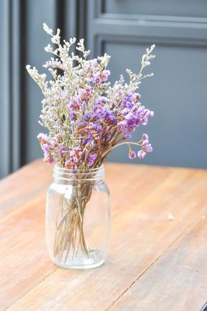 dried flower arrangement: statice flowers in a vase ,blur background Stock Photo