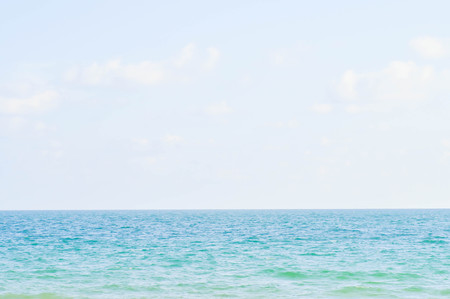 spurt: sea, sky and could in blur background Stock Photo