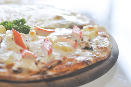 ready to cook food: Hawaiian pizza on the table Stock Photo