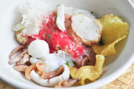 fish ball: Yong Tau Fu , Chinese noodle or Flat noodles with fish ball in red sauce dish