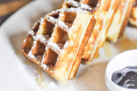 icing sugar: waffle with icing sugar and blueberry dip