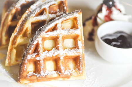 icing sugar: waffle with icing sugar , whipped cream and blueberry dip