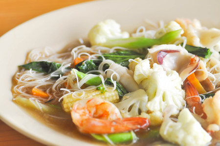 thai noodle: fried noodle with squid , shrimp and vegetable or Thai noodle dish