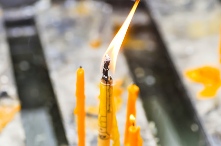 theorem: candle,wax or taper in the temple