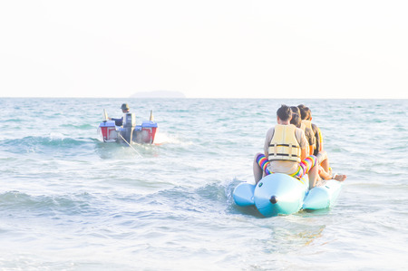 People`s riding a banana boat