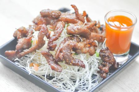 fried noodle: fried pork with fried noodle ,fusion food (Thai food)