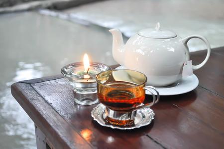 tea pot , a glass of tea and candle Stock Photo - 89995176
