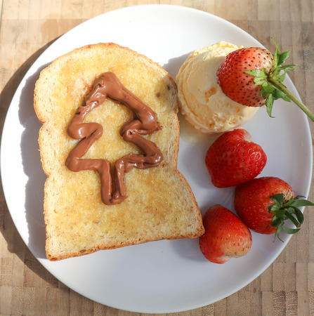 ice cream with strawberry topping and toast