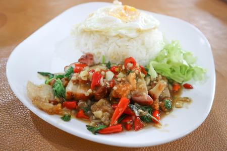 stir fried basil with crispy pork and rice or Thai food
