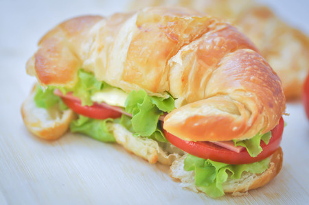 sandwich or croissant sandwich with cheese and ham