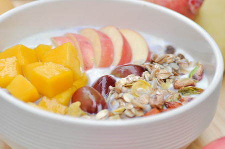 yogurt with apple, mango and grape topping