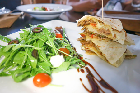 Quesadillas or Mexican pizza and salad