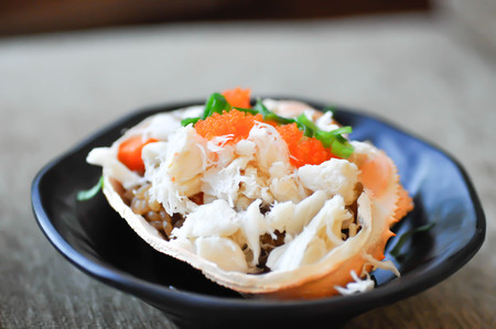 rice topped with crab, steamed crab and rice